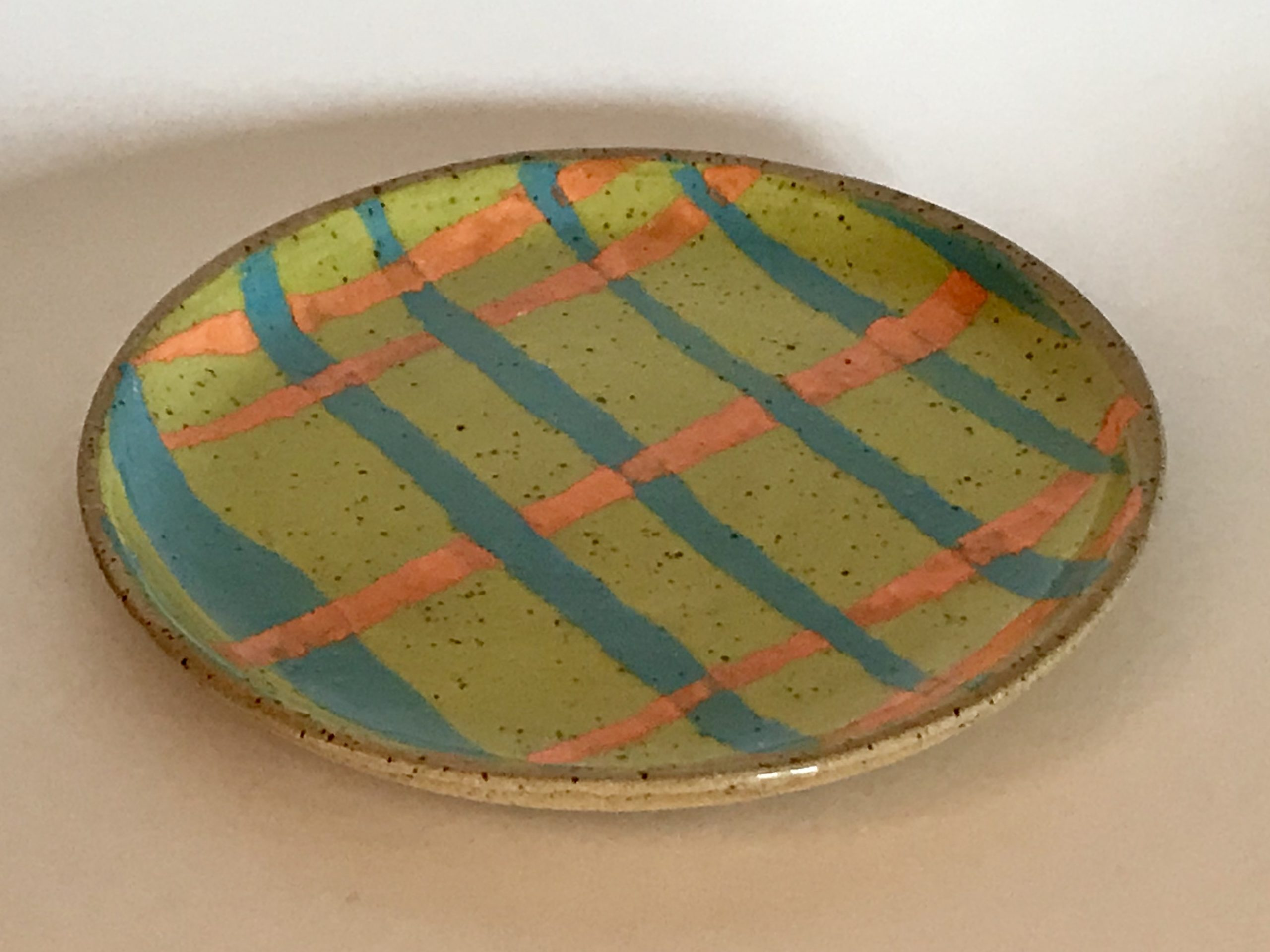 striped ceramic plate made from speckled clay
